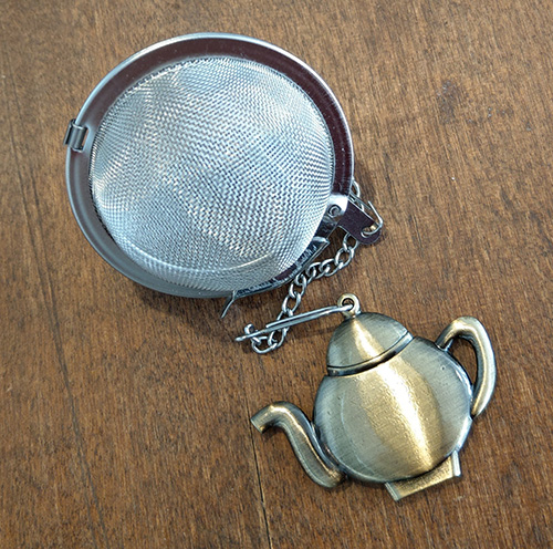 Tea strainer with teapot